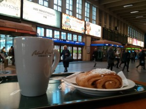 Korvapuusti (cinnamon roll) and coffee in the Helsinki train station.  Photo credit:  Dennis Grice